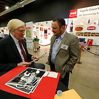 Thomas Wells | Buy at PHOTOS.DJOURNAL.COM<br /> Sandy Williams, left, gets a chance to look at a few historic photos that Myles Russell, right, brought Thursday's 100th Anniversary of Coca-Cola  party held the Tupelo Automobile Museum.
