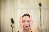 A contestant for the Miss Universe China Pageant  massages her face at a training camp for contestants in Beijing, China on Thursday, June 23, 2011.   The training camp was created by cosmetics businesswoman and Chinese-American television personality Yue-Sai Kan's to give China, which has never won a Ms. Universe Contest, a cpotential contender in the upcoming beauty pagent.