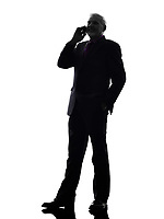 One Caucasian Senior Business Man on the telephone smiling Silhouette White Background