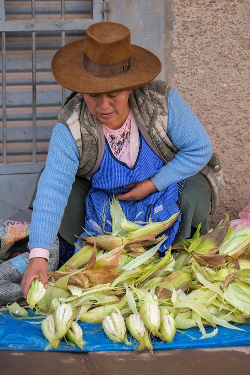 South America, Peru,Juliaca, woman from Cuzco selling corn