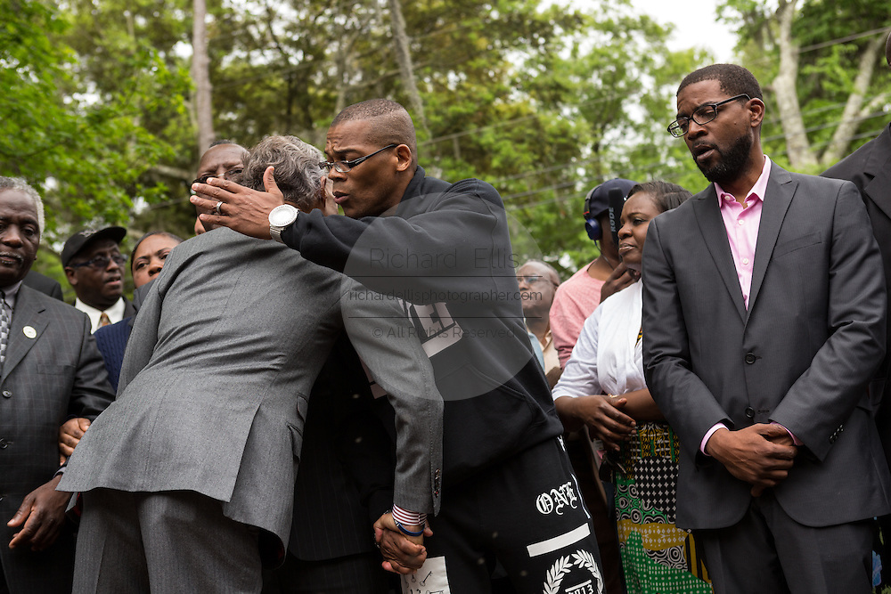 Rev. Al Sharpton hugs a local activist following a peace vigil at the spot where unarmed motorist Walter Scott was gunned down by police April 12, 2015 in North Charleston, South Carolina. About 100 people showed up for the brief vigil following a healing service at Charity Mission Baptist Church.