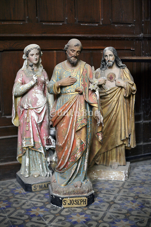 group of damaged religious sculptures in a side room in church