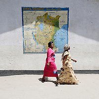 Dar Es Salaam, Tanzania 30 October 2010<br /> Two Tanzanian women walk along a polling station in Dar Es Salaam.<br /> The European Union has launched an Election Observation Mission in Tanzania to monitor the general elections, responding to the Tanzanian government invitation to send observers for all aspects of the electoral process.<br /> The EU sent this observation mission led by Chief Observer David Martin, a member of the European Parliament. <br /> PHOTO: EZEQUIEL SCAGNETTI