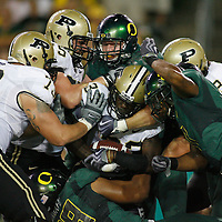 Purdue's Jaycen Taylor (center) is caught between a rock and a hard place during the Ducks' 38-36 victory in a non-conference game, in Autzen Stadium, on Saturday, Sept. 12, 2009.