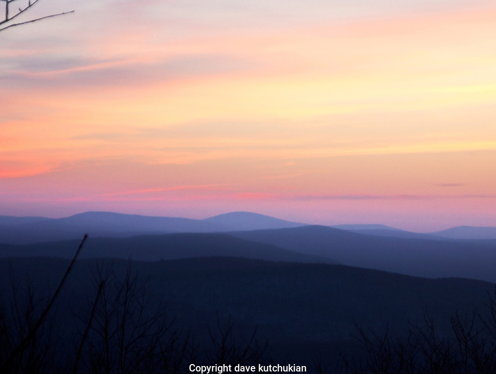 the sunset from a snowmobile trail in green mountain national forest,looking southeast at dusk no property release