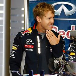 FORMULA 1 SANTANDER BRITISH GRAND PRIX ...Sebastian Vettel chats with his engineers in the Red Bull garage....(c) STEPHEN LAWSON | SportPix.org.uk