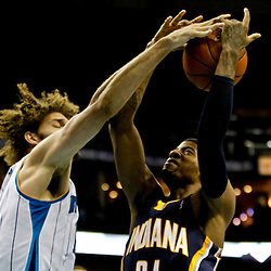 Dec 22, 2012; New Orleans, LA, USA; New Orleans Hornets center Robin Lopez (15) blocks a shot by Indiana Pacers small forward Paul George (24) during the second quarter of a game at the New Orleans Arena. Mandatory Credit: Derick E. Hingle-USA TODAY Sports