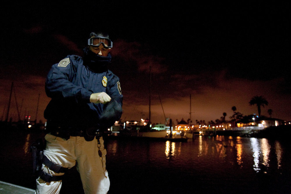 """Keley Hill, Director of Marine Interdiction unit of  Customs and Border Protection, .San Diego Air & Marine Branch, prepares to patrol the waters near the US/Mexico border for undocumented immigrants in the early morning hours. The unit is also on patrol for gun smugglers hauling firearms into Mexico which is helping to fuel the Narco wars raging in Mexico. For more images, search for """"immigration by air and sea"""". Please contact Todd Bigelow directly with your licensing requests."""