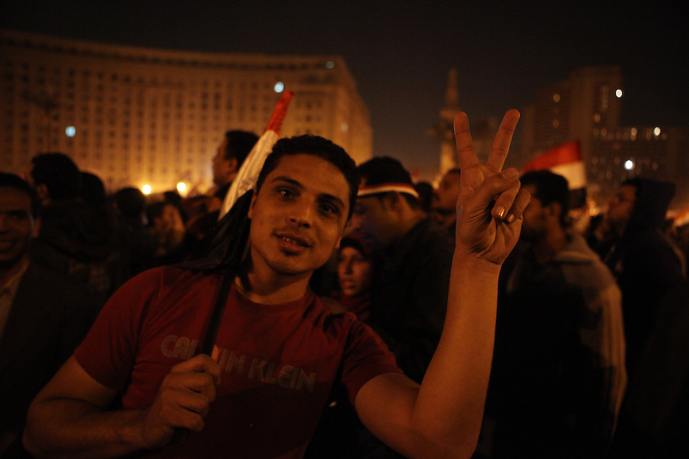Pro-democracy protesters celebrate at Tahrir Square minutes after Vice President Omar Suleiman announced live on TV that Hosni Mubarak had resigned as president of Egypt.