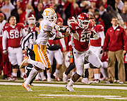 Nov 12, 2011; Fayetteville, AR, USA; Arkansas Razorback running back Broderick Green (29) gets past Tennessee Volunteers defensiveback Prentiss Waggner (23) during the second half at Donald W. Reynolds Razorback Stadium. Arkansas defeated Tennessee 49-7. Mandatory Credit: Beth Hall-US PRESSWIRE