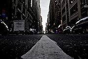 White line on the ground in the middle of a street in Midtown Manhattan, New York, 2009.