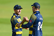 Andrew Salter of Glamorgan celebrates the team win with teammate David Millar of Glamorgan during the NatWest T20 Blast South Group match between Kent County Cricket Club and Glamorgan County Cricket Club at the Spitfire Ground, Canterbury, United Kingdom on 30 July 2017. Photo by Martin Cole.