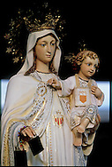 DADE CITY, FLORIDA:  A statue of the Virgin Mary holding the baby Jesus at the home of Vimer Nagun who cliamed to have visions of the Virgin Mary. Since Nagun's first apparitions, thousands of pilgrims have visited the teens home in the quest from the Mother of Jesus.(Photo by Robert Falcetti). .
