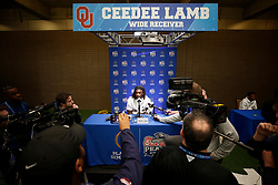CeeDee Lamb #2 of the Oklahoma Sooners speaks with the media at Media Day on Thursday, Dec. 26, in Atlanta. LSU will face Oklahoma in the 2019 College Football Playoff Semifinal at the Chick-fil-A Peach Bowl. (Jason Parkhurst via Abell Images for the Chick-fil-A Peach Bowl)