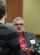Ryan Frederick, the principal of AWH and director of Startup Grind and a speaker and coach at Startup Weekend Athens, talks to fellow coach Nathaniel Berger at the Ohio University Innovation Center on March 19, 2016.