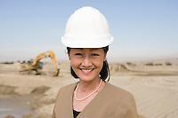 Female surveyor on construction site, portrait