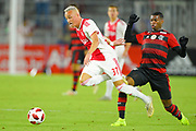 Ajax midefielder Noa Lang (37) is tripped by Flamengo midfielder Jean Lucas (18) during a Florida Cup match at Orlando City Stadium on Jan. 10, 2019 in Orlando, Florida. <br /> Flamengo won in penalties 4-3.<br /> <br /> ©2019 Scott A. Miller