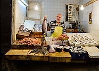 FEZ, MOROCCO - CIRCA APRIL 2017:  Portrait of Moroccan fish seller at the Medina in Fez