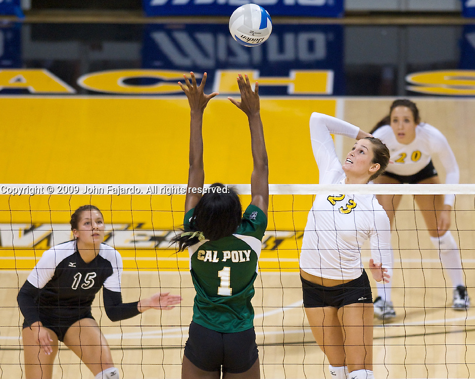 Brittney Herzog(23)  hits for Long Beach State with Dominique Olowolafe(1) blocking in the Big West Conference game against Cal Poly at the Walter Pyramid, Long Beach CA, Saturday Oct. 3, 2009.