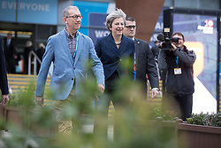 © Licensed to London News Pictures . 02/10/2017. Manchester, UK. Prime Minister THERESA MAY and husband PHILIP MAY cross to the Midland Hotel after visiting the conference centre , at the start of the second day of the Conservative Party Conference at the Manchester Central Convention Centre . Photo credit: Joel Goodman/LNP
