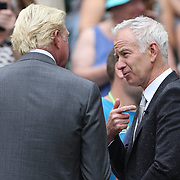 LONDON, ENGLAND - JULY 14: Boris Becker of Germany and John McEnroe of the United States filming a television segment on Center Court during the Wimbledon Lawn Tennis Championships at the All England Lawn Tennis and Croquet Club at Wimbledon on July 14, 2017 in London, England. (Photo by Tim Clayton/Corbis via Getty Images)