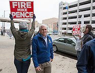 Indiana Governor Mike Pence walks past a few protesters as he arrives at Fiddler's Hearth for Dyngus Day festivities on Monday. Tribune Photo/SANTIAGO FLORES