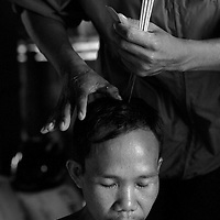 "SIEM REAP, FEBRUARY-28 : a 42 year- old schizophrenic man receives treatment from a traditional healer nearby SiemReap, Cambodia..The country's entire infrastructure, including the health system, was destroyed during the Khmer Rouge reign and years of civil war. Only in recent years , several non governmental organizations have helped provide mental health services and training in the country in collaboration with local healers..Mental health service is relatively new to Cambodia, but much needed. Before the Pol Pot regime Cambodia only had one mental hospital for the whole population which was destroyed during the years of horror..Modest by western standards, the first mental health clinic for all of Cambodia was set up in Siem Reap by a team from Harvard University in 1994. .This is because many refugees settled down in and around Siem Reap. 102 doctors and counsellers were trained by the Harvard specialists in the late nineties as more than 80 percent of the population was traumatized by the Pol Pot years, and even more during their years in the refugee camps. Studies have shown that most  Cambodians showed PTSD ( Posttraumatic Stress Disorder) symptoms similiar to the Jewish survivors of concentration camps. . .As for the future, Cambodians are sceptical if there'd be a fair trial for the people . It'd be very difficult to bring patients to the capital Phnom Penh to witness . Due to Cambodias underdevelopped infrastructure, many Cambodians are even not aware of the trial preparations. There's no money and also many people do not want to be reminded. says a counselor in Siem Reap:""  it only would open old wounds. People rather suffer in silence"".."