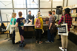 © Licensed to London News Pictures. 07/04/2016. Visitors sample coffee on the stands at The London Coffee Festival. Now its 4th year, will attract over 35,00 visitors over the four day event. London, UK. Photo credit: Ray Tang/LNP