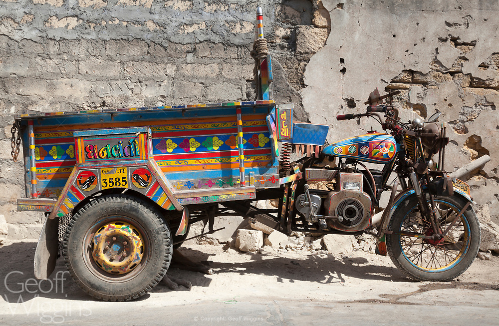 The Chhakda is a rugged multiple-use vehicle that is based in a diesel powered Royal Enfield motorcycle. With a high load-carrying capacity it it also used as a rural taxi. With fares of Rs 2-3 to go from one village to another, it is a cheap mode of transport. Gujarat, India.
