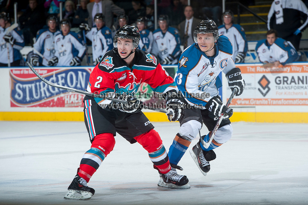 KELOWNA, CANADA - DECEMBER 7: Jesse Lees #2 of the Kelowna Rockets is checked by Sam Reinhart #23 of the Kootenay Ice on December 7, 2013 at Prospera Place in Kelowna, British Columbia, Canada.   (Photo by Marissa Baecker/Shoot the Breeze)  ***  Local Caption  ***