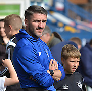Ryan Lowe watches bury warm up before the Sky Bet League 1 match between Bury and Port Vale at Gigg Lane, Bury, England on 19 September 2015. Photo by Mark Pollitt.