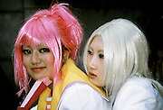 Cosplay girls in colourful wigs on the Meiji Jingu bridge in Harajuku, Tokyo, Japan 2004
