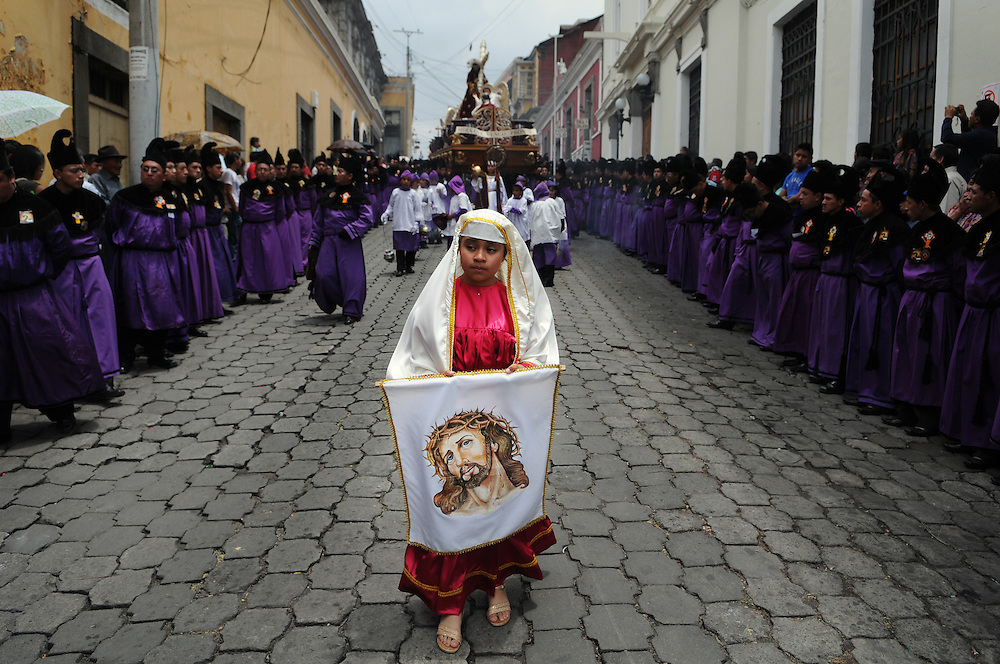 "Apr 22, 2011 - Quetzaltenago, Guatemala - Semana Santa or Holy Week continued in Quetzaltenago with the ""Procession to the Cathedral"" Resident of the second largest city in Guatemala lined the streets of the Procession route leading into the Central Park. A young girl dressed as the Virgin Mary carries an image of Jesus Christ as she walks down the Procession Route Friday Morning..(Credit Image: © Josh Bachman/ZUMA Press)"