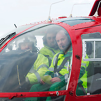 SCAA..Scotland's Charity Air Ambulance have started to train the five paramedics who will man the new Air Ambulance to be based in Perth, pictured from left pilot Peter Quick giving a flying brief to paramedics Alex Holden from Falkirk and Bruce Rumgay from Dundee in a Bolkow 105 from Bond Aviation Services who have been chosen to provice the aircraft for SCAA where it joined up with the paramedics in a snowy Perth to start the training process....24.01.13<br /> For further info contact Maureen Young on 07778 779888<br /> Picture by Graeme Hart.<br /> Copyright Perthshire Picture Agency<br /> Tel: 01738 623350  Mobile: 07990 594431