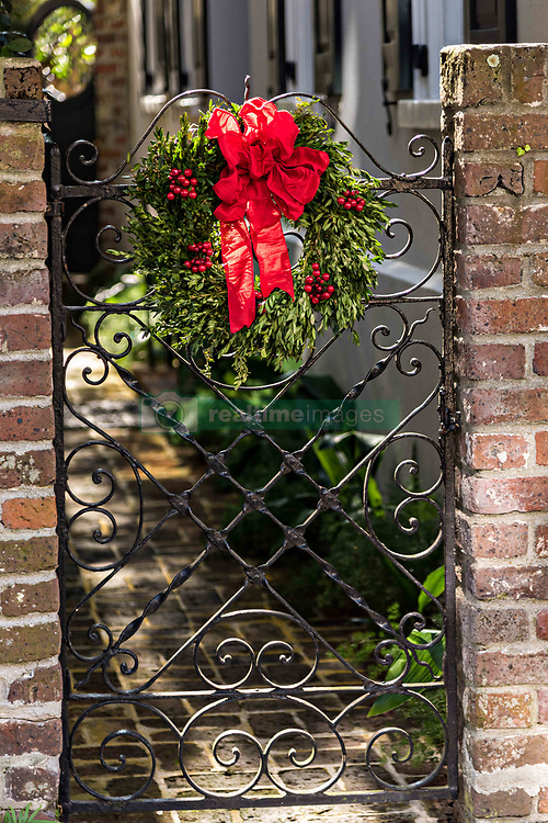 December 21, 2017 - Charleston, South Carolina, United States of America - A wrought iron gate with a Christmas wreath at a historic home on Tradd Street in Charleston, SC. (Credit Image: © Richard Ellis via ZUMA Wire)