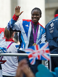 © London News Pictures. 10/09/2012. London, UK . Boxer Nicola Adams waving from a float. Athletes take part in an open top bus victory parade through central London on September 10, 2012 to honour achievements of Team GB in both the Olympic and Paralympic Games. Photo credit: Ben Cawthra/LNP