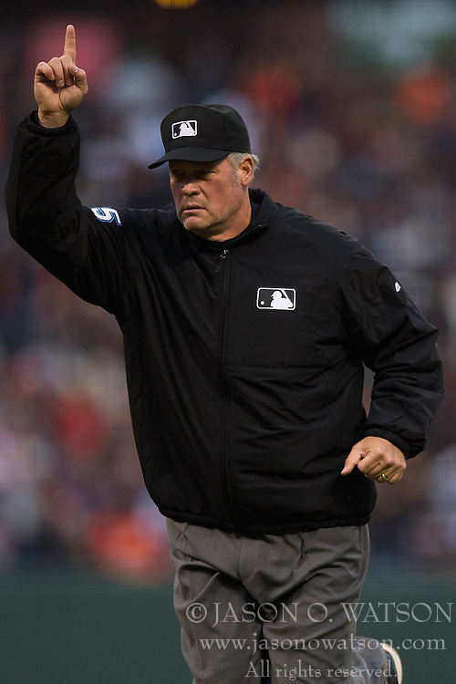 SAN FRANCISCO, CA - MAY 20:  MLB umpire Ted Barrett #65 signals for a replay review during the first inning between the San Francisco Giants and the Los Angeles Dodgers at AT&T Park on May 20, 2015 in San Francisco, California.  The San Francisco Giants defeated the Los Angeles Dodgers 4-0. (Photo by Jason O. Watson/Getty Images) *** Local Caption *** Ted Barrett