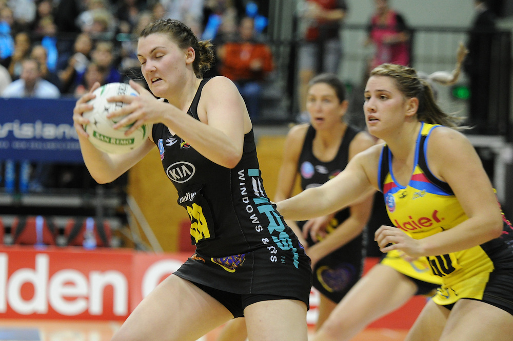 Magics' Ellen Halpenny takes the ball in front of the Pulses' Te Huinga Reo Selby-Rickit in the ANZ Netball Champions at TSB Stadium, Wellington, New Zealand, Sunday, April 28, 2013. Credit:SNPA / Ross Setford