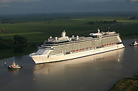 The new Celebrity Cruises 2,850-guest Celebrity Equinox  in transit between the Meyer Werft ship building yard in Papenburg, Germany and Emshaven, Netherlands making the 42-km transit  down the River Ems.