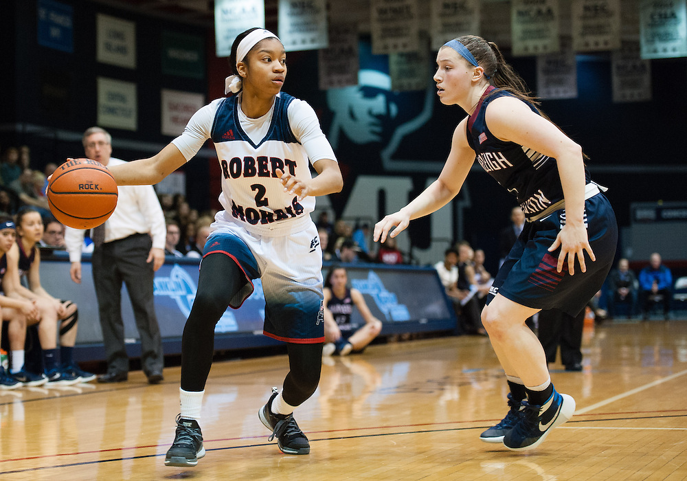 March 6 2016: Robert Morris Colonials guard Nia Adams (2) handles the ball while being guarded by Fairleigh Dickinson Lady Knights guard Madelynn Comly (1) during the first half in the NCAA Women's Basketball game between the Fairleigh Dickinson Lady Knights and the Robert Morris Colonials at the Charles L. Sewall Center in Moon Township, Pennsylvania (Photo by Justin Berl)