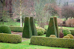 Clipped yew pillars and box hedging in the parterre at Pettifers. Taxus baccata, Buxus sempervirens