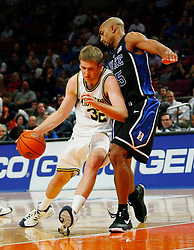 Nov 21, 2008; New York, NY, USA; Michigan Wolverines forward Zack Gibson (32) tries to dribble past Duke Blue Devils forward Gerald Henderson (15) during the 2K Sports Classic Championship game at Madison Square Garden. Duke won 71-56.