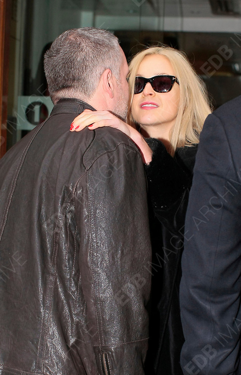 27.FEBRUARY.2012. LONDON<br /> <br /> FEARNE COTTON GETS A KISS FROM FELLOW PRESENTER CHRIS MOYLES AT THE RADIO 1 STUDIOS IN LONDON<br /> <br /> BYLINE: EDBIMAGEARCHIVE.COM<br /> <br /> *THIS IMAGE IS STRICTLY FOR UK NEWSPAPERS AND MAGAZINES ONLY*<br /> *FOR WORLD WIDE SALES AND WEB USE PLEASE CONTACT EDBIMAGEARCHIVE - 0208 954 5968*