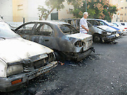 Israel, Sderot, house damaged by a Qassam rockets launched by Hamas from Gaza damaged cars November 11th 2007