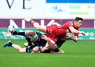Scarlets' Steff Evans is tackled by Glasgow Warriors' Callum Gibbins<br /> <br /> Photographer Simon King/Replay Images<br /> <br /> Guinness PRO14 Round 19 - Scarlets v Glasgow Warriors - Saturday 7th April 2018 - Parc Y Scarlets - Llanelli<br /> <br /> World Copyright &copy; Replay Images . All rights reserved. info@replayimages.co.uk - http://replayimages.co.uk