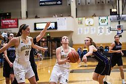 Maddie Knight eyes basket during 2017, Girls Basketball NHS vs Northwestern., on 12, 21, 2017