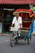 Liulichang art and antiquities street. Trishaw wating for tourists.