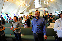 In an airy, open sanctuary lit by street-level stained glass, a congregation of true believers prayed, sang and chanted through an early morning Easter Sunday service at Cristo La Roca Church in East Salinas.