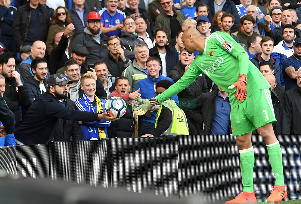 Watford goalkeeper Heurelho Gomes asks for the ball back from the Chelsea fans during the Premier League match at Stamford Bridge, London.
