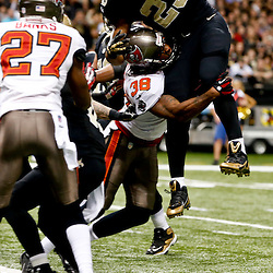 Dec 29, 2013; New Orleans, LA, USA; New Orleans Saints running back Pierre Thomas (23) leaps over Tampa Bay Buccaneers free safety Dashon Goldson (38) for a touchdown during the third quarter of a game at the Mercedes-Benz Superdome. Mandatory Credit: Derick E. Hingle-USA TODAY Sports